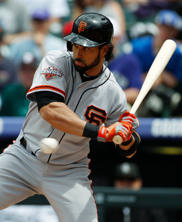 . San Francisco Giants leadoff hitter Angel Pagan avoids an inside pitch against the Colorado Rockies in the first inning of a baseball game in Denver on Sunday, May 19, 2013. (AP Photo/David Zalubowski)