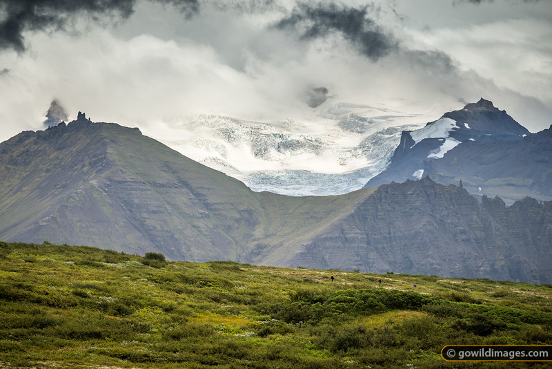 Walkers enjoy the glacial view of Vatnajökull National Park, above Skaftafell
