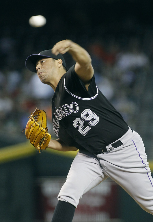 . Starting pitcher Jorge De La Rosa #29 of the Colorado Rockies delivers a pitch against the Arizona Diamondbacks during the first inning of a MLB game at Chase Field on August 31, 2014 in Phoenix, Arizona.  (Photo by Ralph Freso/Getty Images)