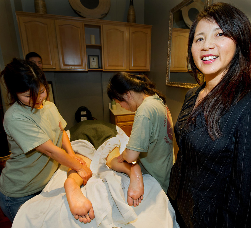 . Alice Taylor, right, Director of AcuSpa and Massage School of Pasadena with two of her students Mayumi Yasunaga of Azusa, left, and Annie Ruimin Vitzthum that is located at 350 South Lake Avenue in Pasadena Thursday, April 17, 2014.(Photo by Walt Mancini/Pasadena Star-News)