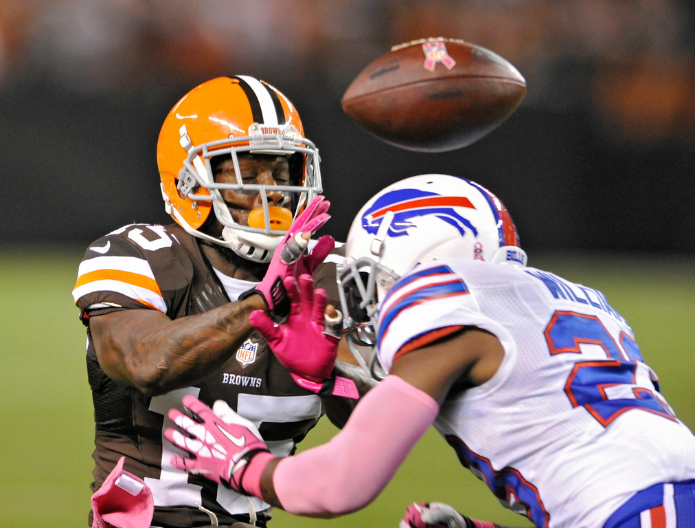 . Buffalo Bills free safety Aaron Williams, right, breaks up a pass for Cleveland Browns wide receiver Davone Bess in the first quarter of an NFL football game Thursday, Oct. 3, 2013, in Cleveland. Williams was called for unnecessary roughness for a helmet-to-helmet hit. (AP Photo/David Richard)