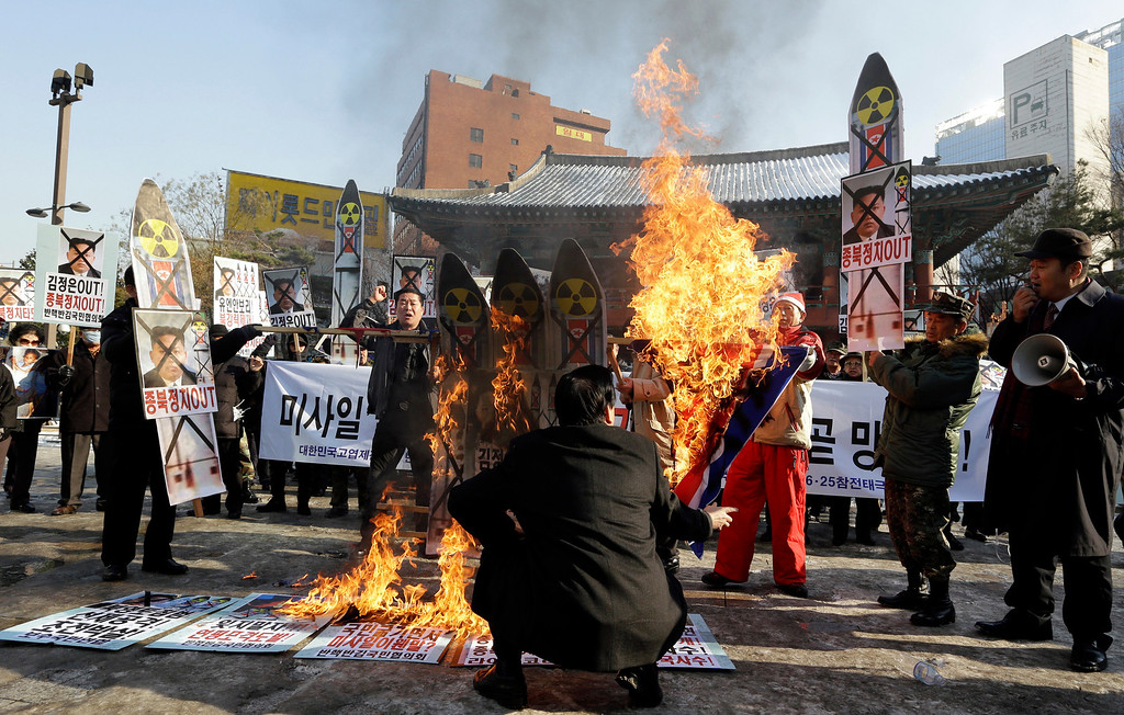 . South Korean protesters burn the pictures of North Korean leader Kim Jong Un, North Korea flags and mock missiles during a rally denouncing North Korea\'s rocket launch in Seoul, South Korea, Wednesday, Dec. 12, 2012. North Korea successfully fired a long-range rocket on Wednesday, defying international warnings as the regime of Kim Jong Un took a giant step forward in its quest to develop the technology to deliver a nuclear warhead. (AP Photo/Lee Jin-man)
