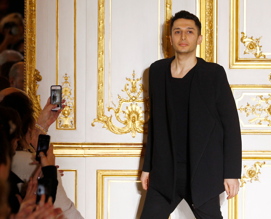 . Jordan-born fashion designer Rad Hourani reacts after the presentation of his  Spring-Summer 2014 Haute Couture fashion collection presented in Paris, Wednesday, Jan.22, 2014. (AP Photo/Remy de la Mauviniere)