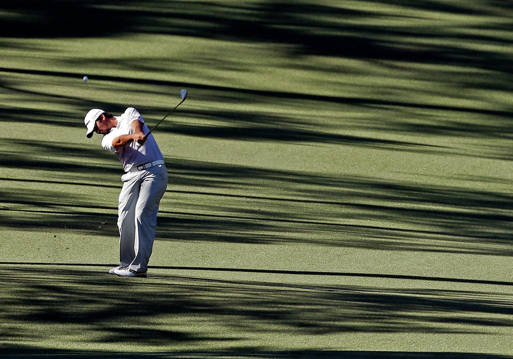 . Jason Day, of Australia, hits on the 10th fairway during the third round of the Masters golf tournament Saturday, April 13, 2013, in Augusta, Ga. (AP Photo/Charlie Riedel)