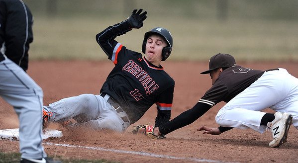 4/11/2019 Mike Orazzi | Staff Terryville's Colby Rheault (12) slides safely into third as Thomaston's Isaiah Johnson (17 ) applies the lag tag during Thursday's baseball game at Terryville High School.