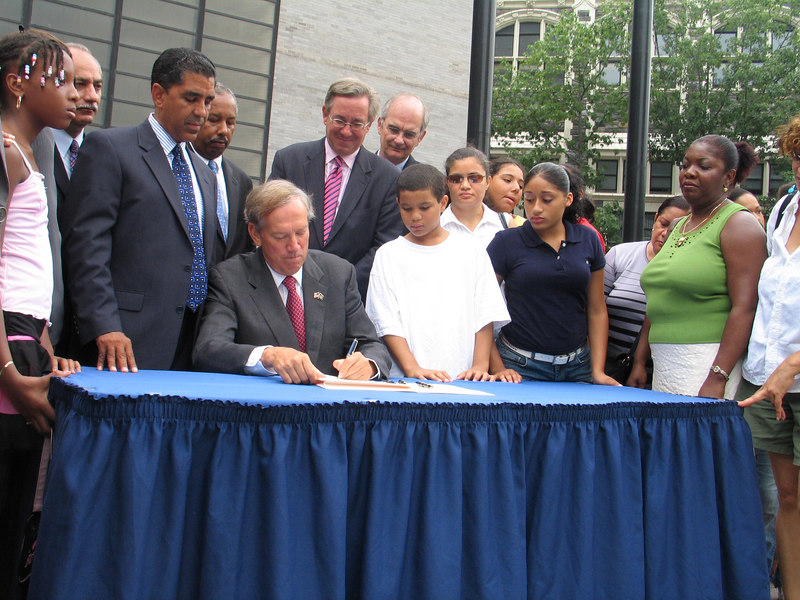 Governor George E. Pataki signs legislation, sponsored by State Senator John D. Sabini and Assemblyman Adriano Espaillat, that establishes a scholarship for relatives and dependants of victims of the AA Flight 587 airplane crash of Nov. 12, 2001.  Photo © Shams Tarek (shams.m.tarek@gmail.com)