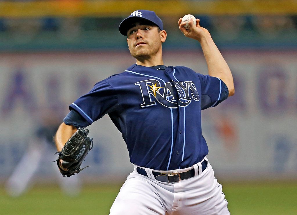 . Tampa Bay Rays starting pitcher Matt Moore throws during the first inning of a baseball game against the Twins. (AP Photo/Mike Carlson)