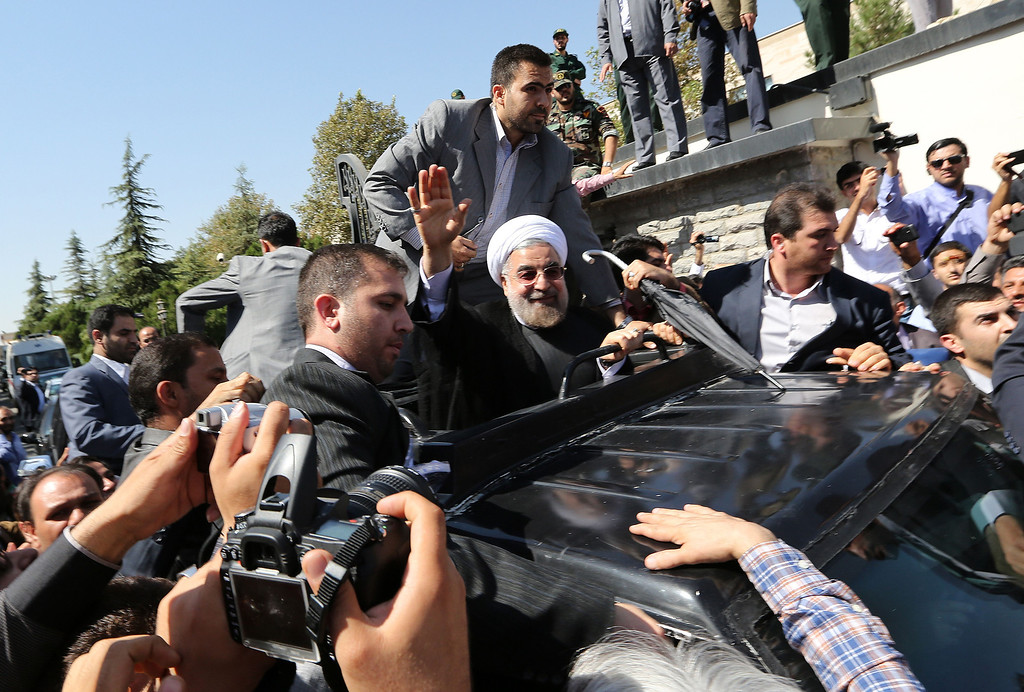 ". Iranian president Hassan Rouhani waves to supporters as his motorcade leaves Tehran\'s Mehrabad Airport upon his arrival from New York, on September 28, 2013. Hardline Islamists chanted ""Death to America\"" and \""Death to Israel\"" but they were outnumbered by 200 to 300 supporters of the president who shouted: \""Thank you Rouhani.\""    ATTA KENARE/AFP/Getty Images"