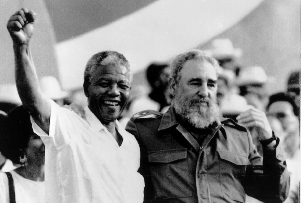 ". Cuban President Fidel Castro, right, and African leader Nelson Mandela gesture during the celebration of the ""Day of the Revolution\"" in Matanzas Saturday, July 27, 1991. Cubans celebrate 38th anniversary of the revolution. (AP Photo/Alejandro Balaguer)"