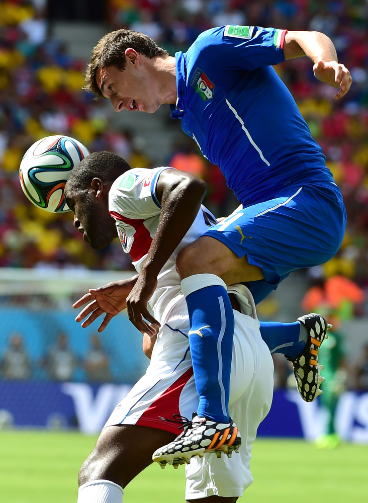 . Italy\'s defender Matteo Darmian (R) challenges Costa Rica\'s defender Junior Diaz during a Group D match between Italy and Costa Rica at the Pernambuco Arena in Recife during the 2014 FIFA World Cup on June 20, 2014.   (RONALDO SCHEMIDT/AFP/Getty Images)