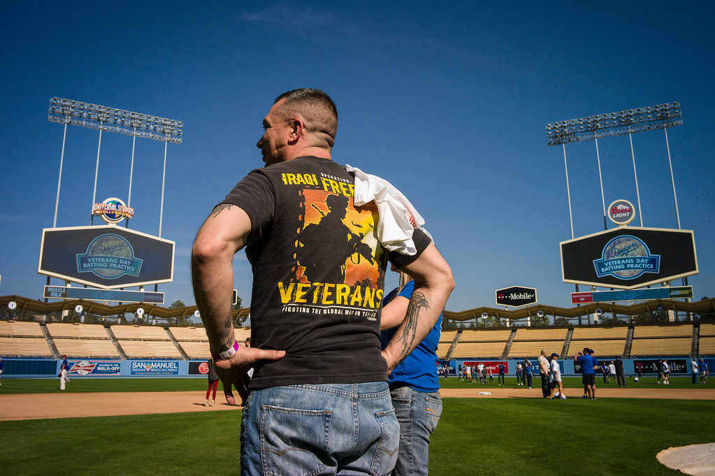 . David Boone of the US Army surveys the view from home plate during  Veterans Day at Dodger Stadium Monday, November 11, 2013.  The dodgers hosted 100 active duty and retired military to Dodger Stadium to take part in batting practice, enjoy and Dodger lunch and tour the facilities.    ( Photo by David Crane/Los Angeles Daily News )