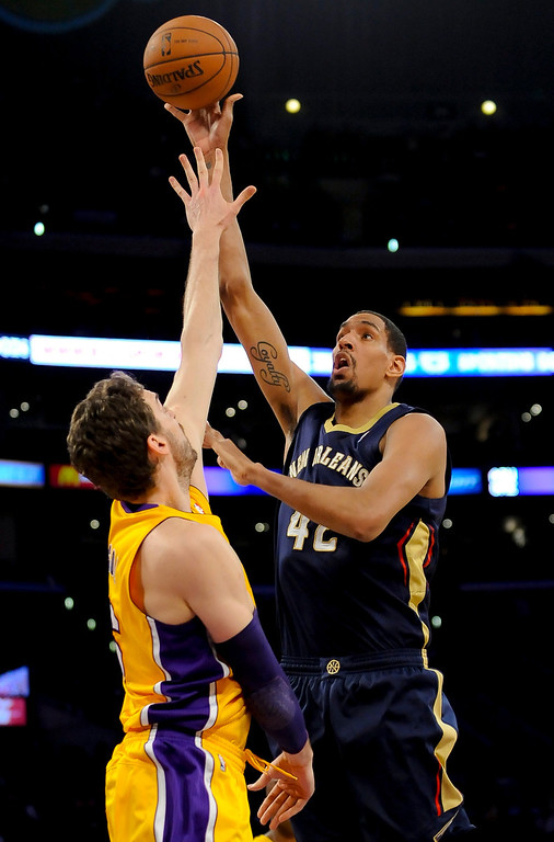 . New Orleans Pelicans center Alexis Ajinca (42), of France, shoots over Los Angeles Lakers center Pau Gasol (16), of Spain, during the first half of an NBA basketball game, Tuesday, March 4, 2014, in Los Angeles.(AP Photo/Gus Ruelas)