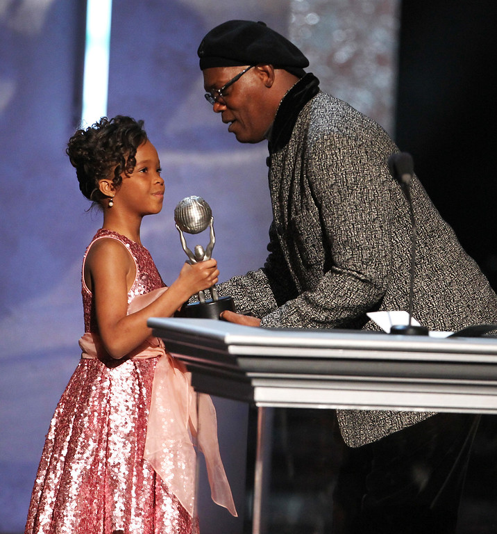". Quvenzhane Wallis, left, accepts the award for outstanding actress in a motion picture on behalf of Viola Davis for ""Won\'t Back Down\"" from Samuel L. Jackson, at the 44th Annual NAACP Image Awards at the Shrine Auditorium in Los Angeles on Friday, Feb. 1, 2013. (Photo by Matt Sayles/Invision/AP)"
