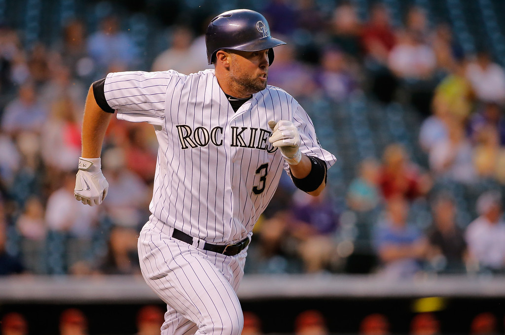 . DENVER, CO - SEPTEMBER 18:  Michael Cuddyer #3 of the Colorado Rockies rounds the bases on his solo home run off of starting pitcher Vidal Nuno #54 of the Arizona Diamondbacks to give the Rockies a 1-0 lead in the second inning at Coors Field on September 18, 2014 in Denver, Colorado.  (Photo by Doug Pensinger/Getty Images)