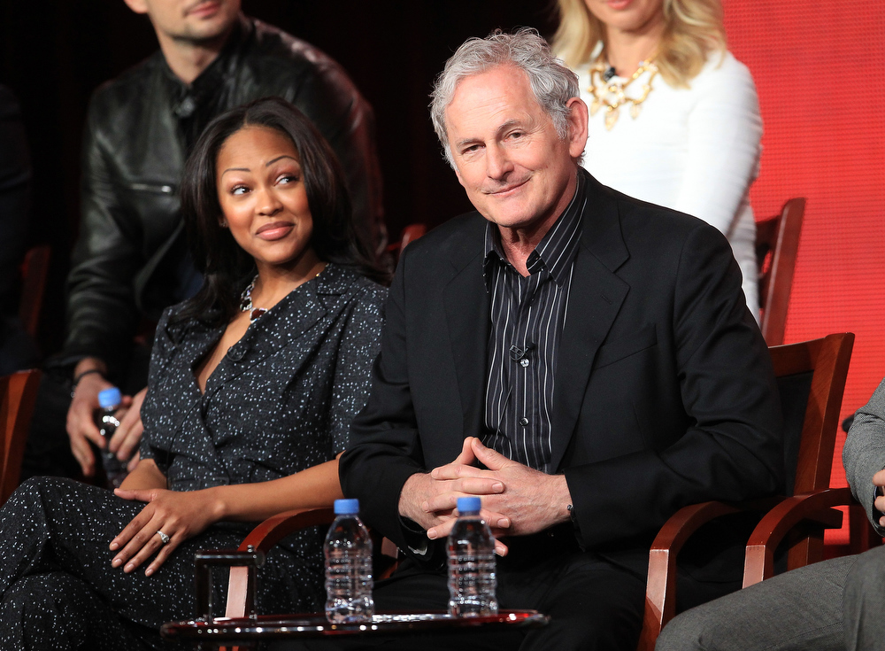 Description of . Actors Meagan Good (L) and Victor Garber speak onstage at the