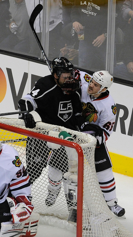 . Kings#13 Justin Williams and Blackhawks#65 Andrew Shaw have an altercation behind the Kings goal in the 2nd period. The Kings played the Chicago Blackhawks in the 3rd game of the Western Conference Finals. Los Angeles, CA 6/4/2013(John McCoy/LA Daily News4