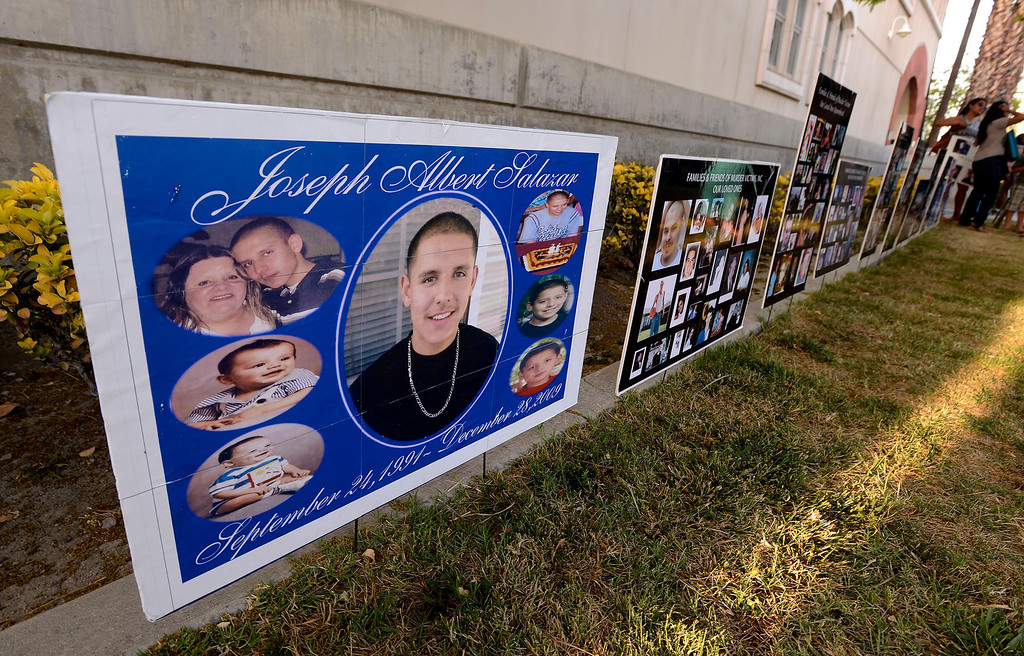 . A row of posters commemorate the lives of homicide victims during the annual Victims Candlelight Vigil at the police station in San Bernardino April 23, 2013.   GABRIEL LUIS ACOSTA/STAFF PHOTOGRAPHER.