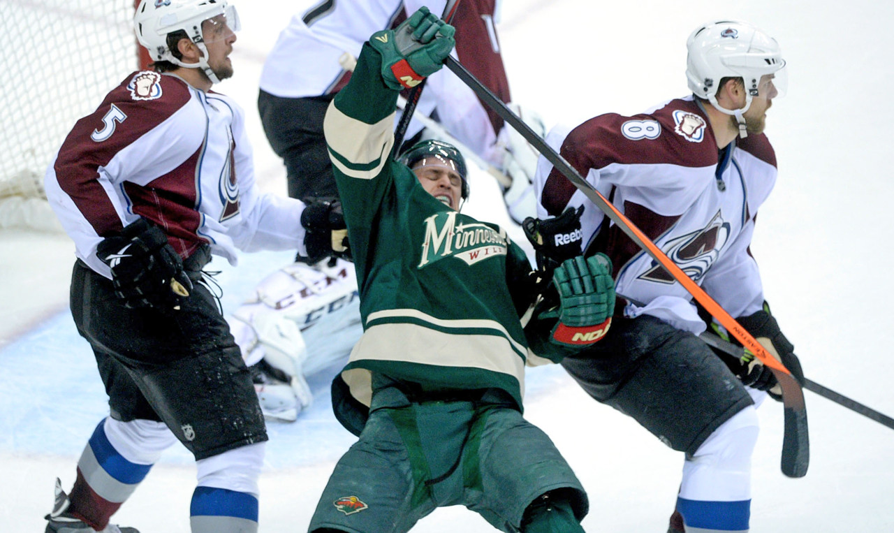 . Minnesota\'s Zach Parise reacts after contact by Avalanche defenseman Nate Guenin, left, who was given two minutes in the box for interference during the second period. (Pioneer Press: Sherri LaRose-Chiglo)