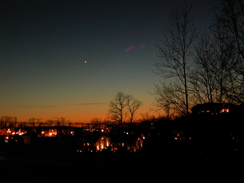 On Jan 17, 2006 I took this image in 26 degree weather of the planet Venus setting in the sunset fom a vantge point near my home; in South Park. On Jan 8, the comet was visible from this same area and dissappeared to the right of the big house that appears in the extream right hand side of this image. Goodbye great Comet...we will miss you! 