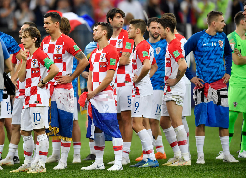 . Croatian players wait for their medals after losing 2-4 during the final match between France and Croatia at the 2018 soccer World Cup in the Luzhniki Stadium in Moscow, Russia, Sunday, July 15, 2018. (AP Photo/Martin Meissner)