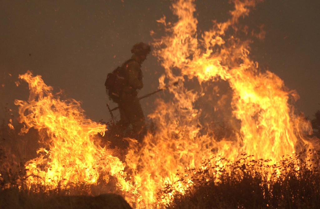 . Captian Randy Greenlee from the Ventura fire department works the front face of the Cedar fire outside Julian, Calif. Tuesday, October 28, 2003. (AP Photo/Tim Tadder)