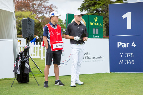 Luke Brown from New Zealand and his caddy on the 1st tee on Day 1 of competition in the Asia-Pacific Amateur Championship tournament 2017 held at Royal Wellington Golf Club, in Heretaunga, Upper Hutt, New Zealand from 26 - 29 October 2017. Copyright John Mathews 2017.   www.megasportmedia.co.nz
