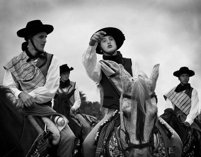 Horsemen dressed as bandoleros. Bandoleros were runaway highwaymen (bandits) usually hiding in the sierra de Ronda in Andalucia.   Guadiaro, Andalucia, Spain. 2011