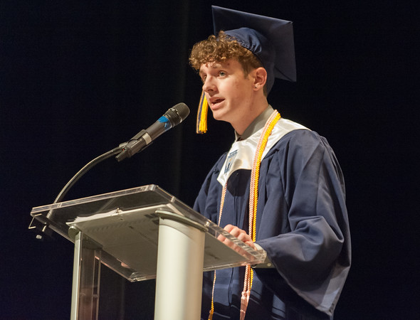 06/21/18 Wesley Bunnell | Staff Newington High School 2018 Essayist Justin Field gives his address during the school's commencement ceremony at The Oakdale Theatre on Thursday evening.