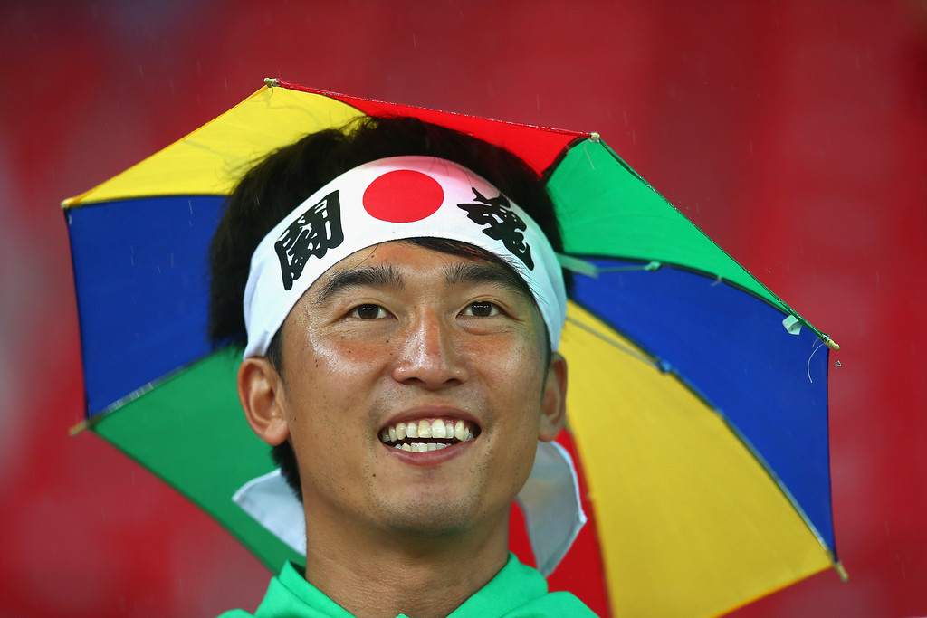 . A Japan fan looks on during the 2014 FIFA World Cup Brazil Group C match  between the Ivory Coast and Japan at Arena Pernambuco on June 14, 2014 in Recife, Brazil.  (Photo by Julian Finney/Getty Images)