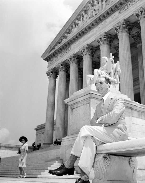 . Justice Frank Murphy, who announced through a court official that he had disqualified himself, sat on a bench outside the U.S. Supreme Court in Washington, D.C., July 29, 1942 as his colleagues of the court assembled to hear a request for a writ of Habeas Corpus for seven of eight alleged Nazi Sabateurs. Murphy has been on active duty as a Lieutenant Colonel in the Army.  (AP Photo)