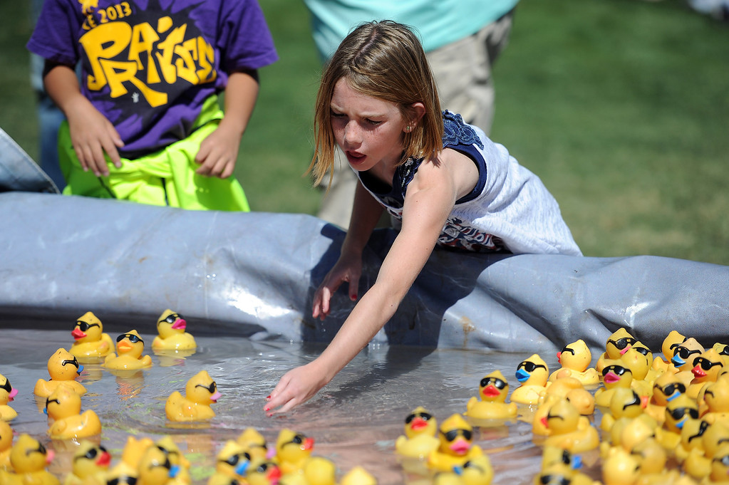 . Ellery O\'Hara, 8-years-old, plays with toy ducks during the  Samuel Dixon Family Health Centers\' 11th annual Rubber Ducky Regatta at Bridgeport Park in Santa Clarita Saturday, October 5, 2013.  The event raises money for charity to help uninsured and underinsured patient care. (Photo by Hans Gutknecht/Los Angeles Daily News)