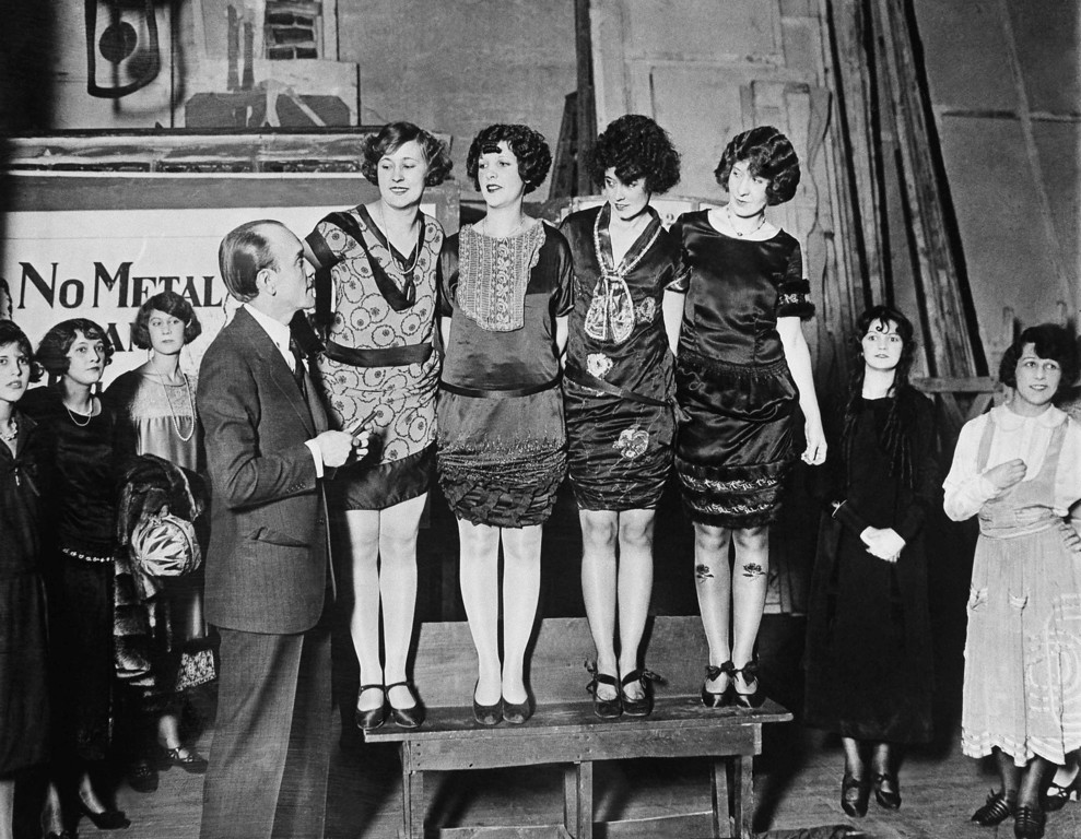 . Earl Carroll musical revue producer making his selection of Washington beauties for the edition of his ?Vanities?, shown on Jan. 24, 1925. Left to rights: The Misses Ethel Adrienne, Polly Shade, Goldie Graingen, Charlotte Wells and Mr. Carroll. (AP Photo)