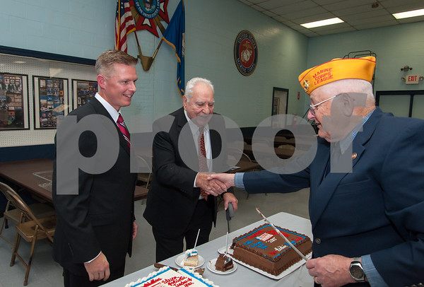 12/07/17 Wesley Bunnell | Staff The VFW of New Britain held their annual officer installation and award ceremony on Thursday evening. Teacher of the year Steve Collins, L, and Ed Mackiewicz, R, veteran of the year as they prepare to cut the cakes.