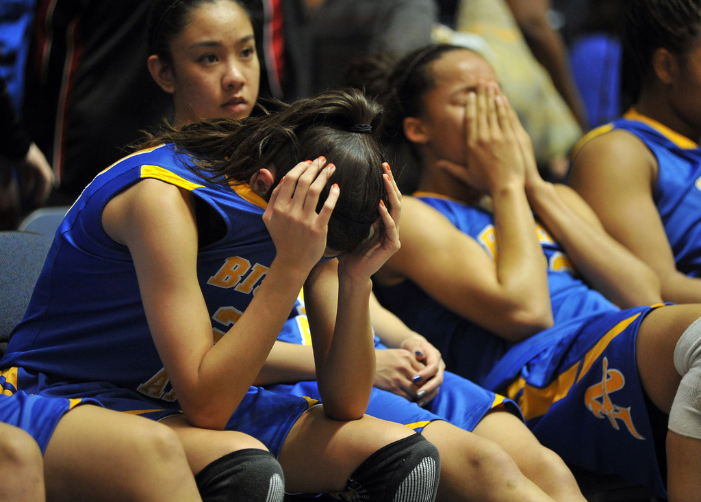 . Bishop Amat\'s Paulina Santana (#21), left, and Mauriana Clayton (#23), right, react after their loss to Canyon Springs in the CIF-SS Division 1A girls basketball finals at the Anaheim Arena on Friday February 28, 2013. Canyon Springs beat Bishop Amat 48-46. (SGVN/Staff Photo by Keith Durflinger)
