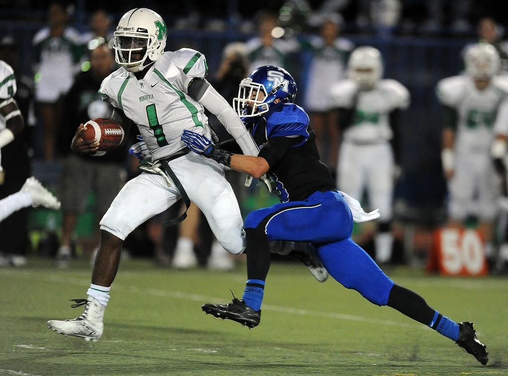 . Monrovia quarterback Deshawn Potts (C) (1) runs for a first down as San Marino\'s Tyler Spitzer (3) tackles in the first half of a prep football game at Monrovia High School in Monrovia, Calif., on Friday, Nov. 8, 2013.    (Keith Birmingham Pasadena Star-News)