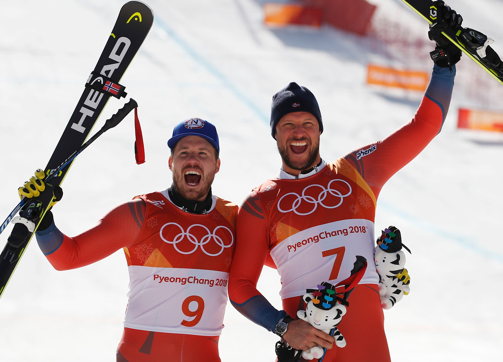 . From left, Norway\'s Kjetil Jansrud, silver, and Norway\'s Aksel Lund Svindal, gold, celebrate during the flower ceremony for the men\'s downhill at the 2018 Winter Olympics in Jeongseon, South Korea, Thursday, Feb. 15, 2018. (AP Photo/Christophe Ena)