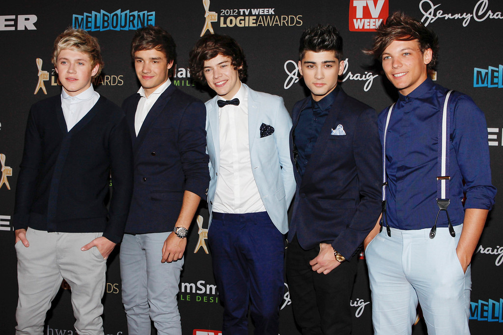 """. This is a Sunday, April 15, 2012 file  photo of British boy-band One Direction arrive for the Logies, an Australian television industry awards night, in Melbourne, Australia. One Direction\'s latest single sums it up. \""""Live While We\'re Young\"""" is the first track off their second album, and the boys are happy to have it as a motto. The members of the British pop group admit they\'re making the most of being young, successful and extremely popular. (AP Photo/Paul Jeffers, File)"""