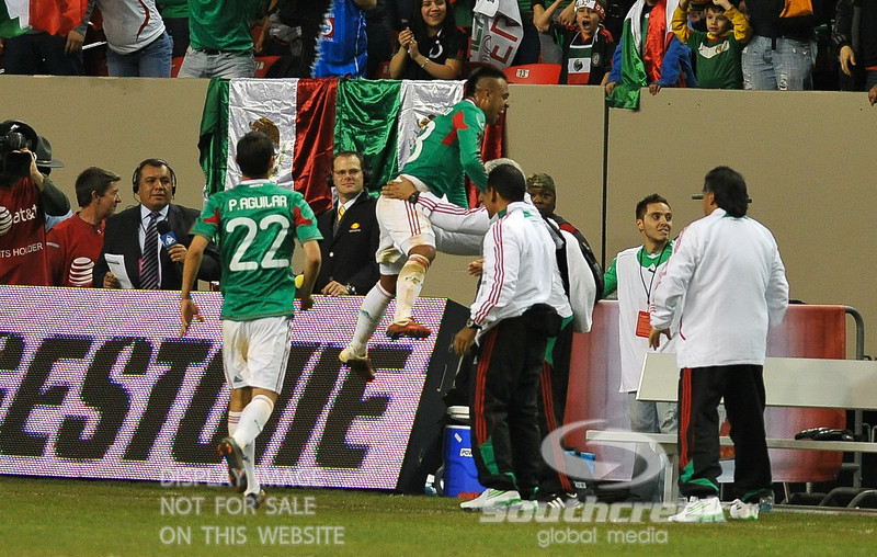 Mexico's Forward Edgar Pacheco (#13) celebrates at the bench area after scoring a goal in Soccer action between Bosnia-Herzegovina and Mexico.  Mexico defeated Bosnia-Herzegovina 2-0 in the game at the Georgia Dome in Atlanta, GA.