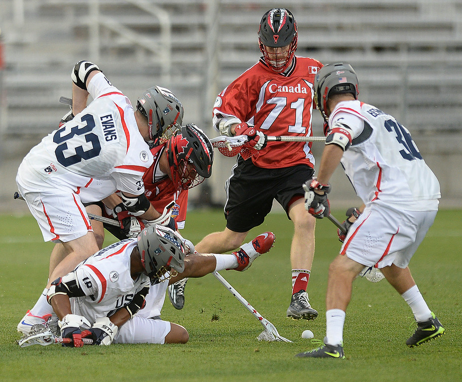 . Players swarmed over a loose ball in the second quarter. The United States took on Canada in the opening game of the FIL World Lacrosse Championships Thursday night, July 10, 2014.   Photo by Karl Gehring/The Denver Post