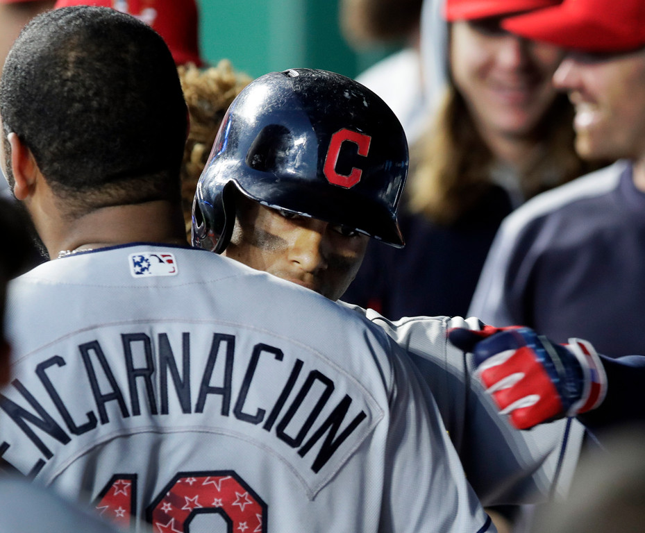 . Cleveland Indians\' Francisco Lindor (12) is congratulated by teammate Edwin Encarnacion after his three-run home run in the fifth inning of a baseball game against the Kansas City Royals at Kauffman Stadium in Kansas City, Mo., Monday, July 2, 2018. (AP Photo/Orlin Wagner)