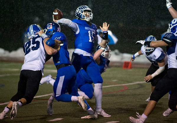 12/09/19 Wesley Bunnell | StaffrrSouthington football was defeated at home in a CIAC playoff game against Darien on a rainy Monday night December 9, 2019. Brady Lafferty (15) stands in the pocket to pass.