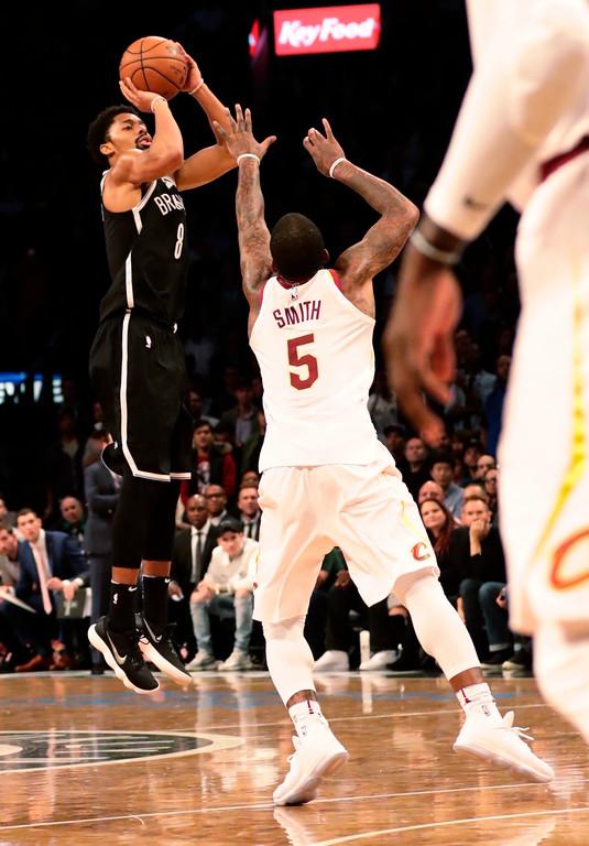 . Brooklyn Nets\' Spencer Dinwiddie (8) shoots a three point basket over Cleveland Cavaliers\' JR Smith (5) during the second half of an NBA basketball game Wednesday, Oct. 25, 2017, in New York. The Nets won 112-107. (AP Photo/Frank Franklin II)