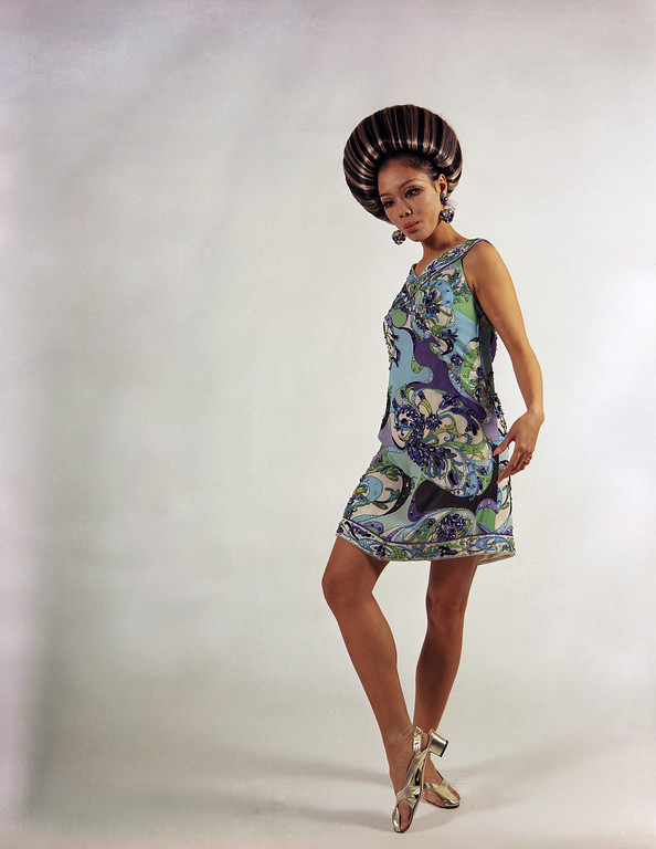 . A cocktail dress of chiffon embroidered in turquoise color tones, created by Emilio Pucci of Florence, presented fashions Italian dress, Jan. 21, 1967. (AP Photo/Mario Torrisi)