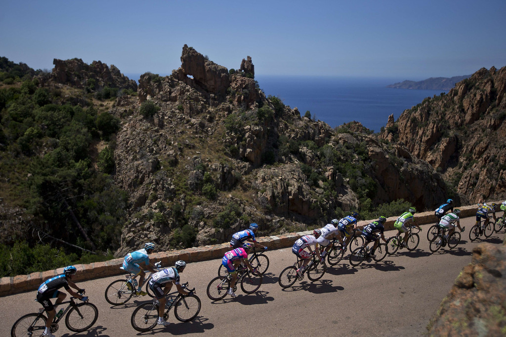 . The pack rides during the 145.5 km third stage of the 100th edition of the Tour de France cycling race on July 1, 2013 between Ajaccio and Calvi, on the French Mediterranean Island of Corsica.JOEL SAGET/AFP/Getty Images
