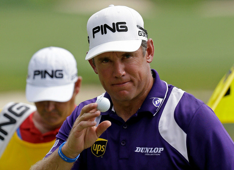 . Lee Westwood, of England, waves after making a birdie putt on the first hole during the final round of the PGA Championship golf tournament at Valhalla Golf Club on Sunday, Aug. 10, 2014, in Louisville, Ky. (AP Photo/John Locher)