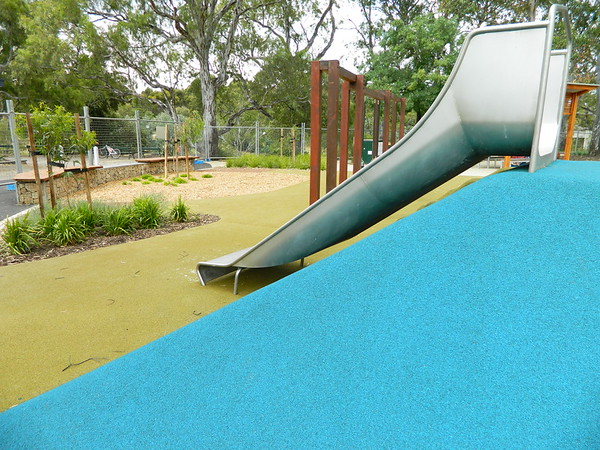 stainless steel slide on blue softfall rubber mound