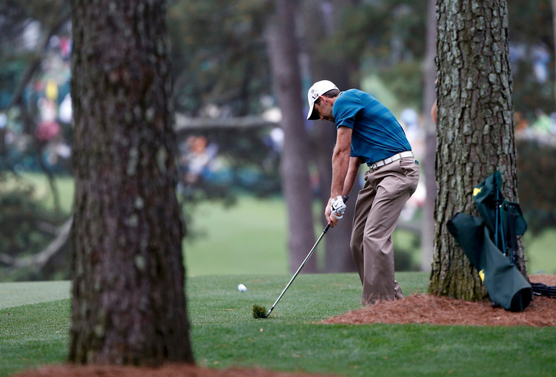 . Former champion Charl Schwartzel of South Africa hits his approach shot to the first green from the tree s during first round play in the 2013 Masters golf tournament at the Augusta National Golf Club in Augusta, Georgia, April 11, 2013.  REUTERS/Mike Segar