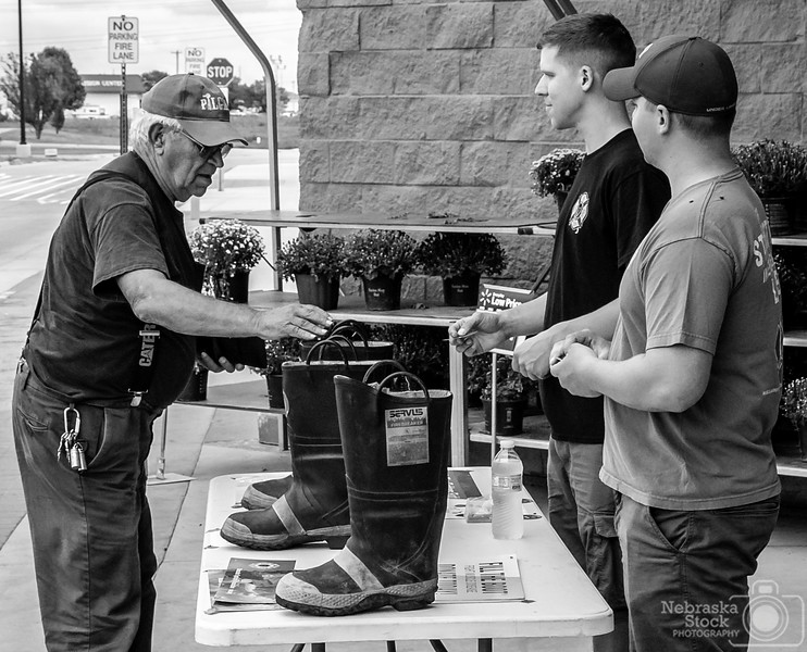 "9-3-2018<br /> 246/365<br /> Members of Norfolk Fire and Rescue thank a donor to their annual fundraiser ""Fill the Boot,"" which goes to muscular dystrophy.<br /> Photo taken with a Sony A6300 with a Sony 18-250<br /> ISO 800<br /> 1/1500th at F8<br /> Picture No. 147662"