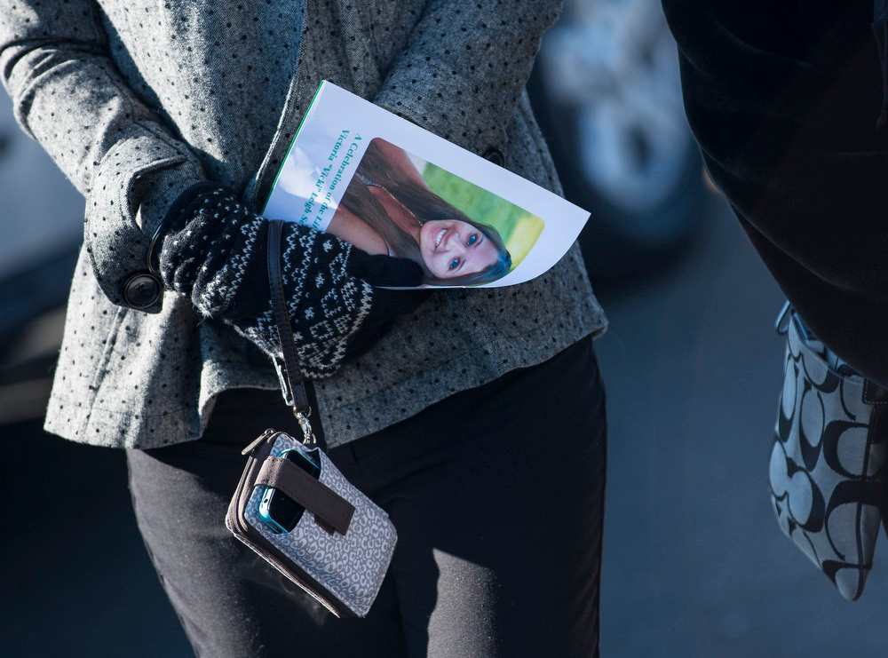 . A woman carries a program with Victoria Soto\'s photo after attending a funeral for the slain teacher at Lordship Community Church December 19, 2012 in Stratford, Connecticut. Victoria Soto, age 27, a first grade teacher who is being hailed as a hero, was one of 6 adults in addition to 20 children who were killed in last Friday\'s shooting at Sandy Hook Elementary School.  AFP PHOTO/Brendan  SMIALOWSKI/AFP/Getty Images
