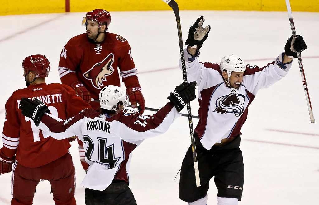 . Colorado Avalanche\'s Patrick Bordeleau, right, celebrates his goal against the Phoenix Coyotes with teammate Tomas Vincour (24), of the Czech Republic, as Cyotes\' Paul Bissonnette, left, and Chris Conner (14) look back at the goal during the first period in an NHL hockey game, on Friday, April 26, 2013, in Glendale, Ariz. (AP Photo/Ross D. Franklin)